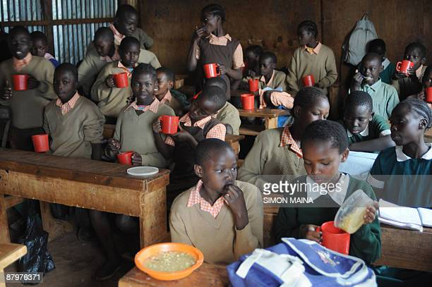 Pupils at the Stara primary school in Nairobi's Kibera slum eat a meal provided by the World Food Program on May 26 2009 as part of a school feeding...