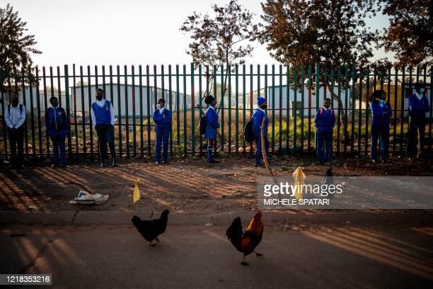 Pupils at the Winnie Mandela Secondary School wait in line outside the school premises before classes resume in the Tembisa township, Ekurhuleni, on...