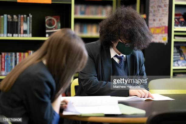 Pupils at work in the library at Willows High School on March 16, 2021 in Cardiff, Wales. Secondary schools in Wales reopen this week having been...