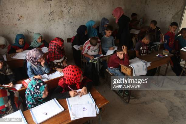 Pupils attend a class at a school in the city of Harim in the rebelheld northern countryside of Syria's Idlib province on October 15 2018 The school...