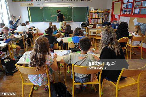 Pupils attend a classroom at the La Courbe primary school in Aytre southwestern France on September 1 as part of the start of the new school year AFP...