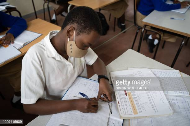 Pupils attend their first class in about eight months at Lycee Notre dame de Citeaux school in Kigali, Rwanda, on November 2 following schools'...