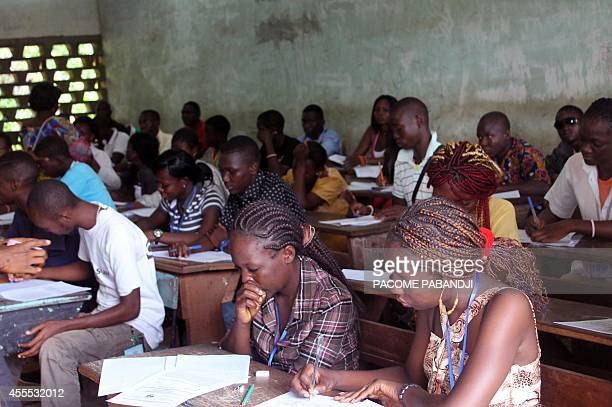 Pupils, both Christian and Moslem, take their baccalauréat exams in Bangui on September 16, 2014. Despite the security situation, the examinations...