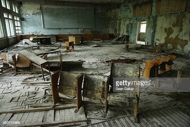 Pupils' chairs stand on rotting floorboards in an auditorium of abandoned School Number 3 on September 30 2015 in Pripyat Ukraine Pripyat lies only a...
