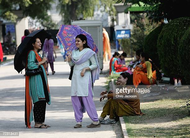 Pupils chat at Fatima Jinnah college on the third day of the Royal Tour of Pakistan on October 31 2006 in Islamabad Pakistan Prince Charles and the...