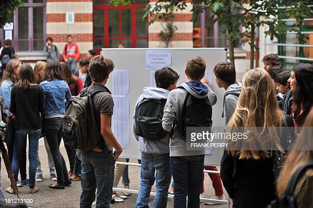 Pupils check classroom lists in a courtyard on September 4, 2012 at the Guist'hau high-school in Nantes, western France, before the start of the new...