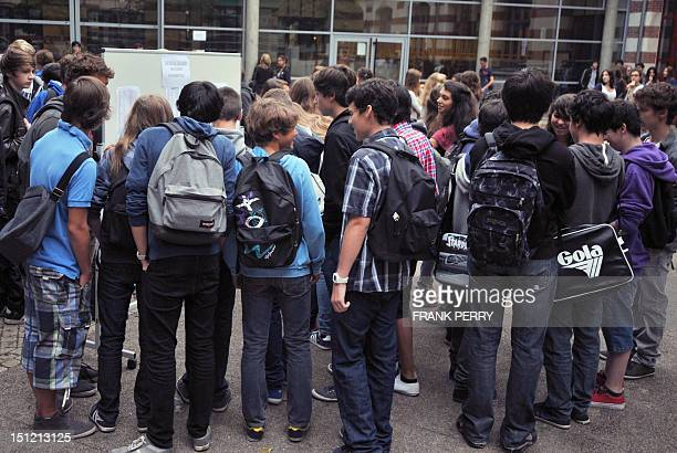 Pupils check classroom lists in a courtyard on September 4 2012 at the Guist'hau highschool in Nantes western France before the start of the new...