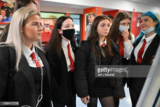 Pupils check their classes on a whiteboard as they return to St Paul's High School for the first time since the start of the coronavirus lockdown...