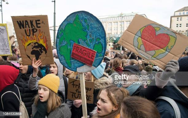 TOPSHOT Pupils demonstrate with posters for climate protection in front of the city hall in Hamburg northern Germany on January 18 2019 They follow...
