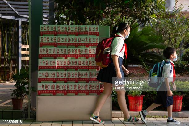 Pupils enter the campus.Wuhan City, Hubei Province, China, September 1, 202- PHOTOGRAPH BY Costfoto / Barcroft Studios / Future Publishing