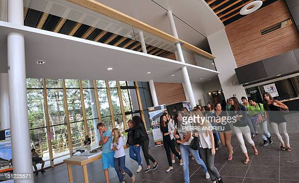 Pupils enter the hall to go in their classrooms at the Vaclav Havel high school in Begles southwestern France for the start of the new school year on...