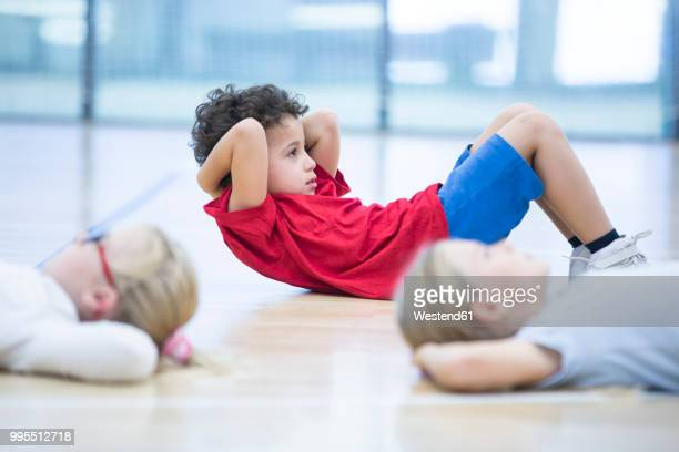 pupils exercising in gym class - physical education stock pictures, royalty-free photos & images