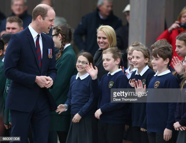 Pupils from All Saints School in Alrewas wave to Prince William Duke of Cambridge during the official opening of a new Remembrance Centre at The...