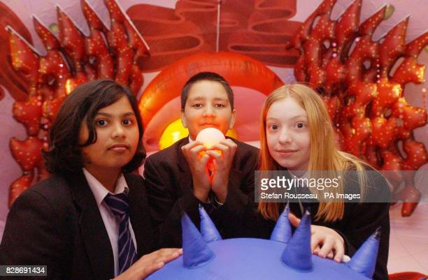 Pupils from Heathland School in Hounslow from left Shweta Pisharoti Neil Mehta and Laura Kirby with an 'energy ball inside a 'Bio Bubble' which is a...