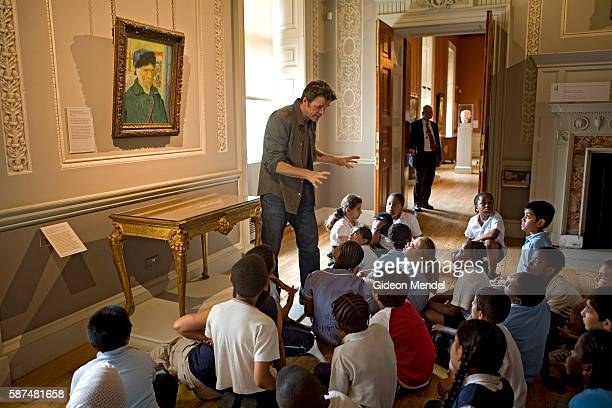 Pupils from Millfields Community School listen to storeyteller Simon Parker telling a tale based on the famous painting by Vincent Van Gough...