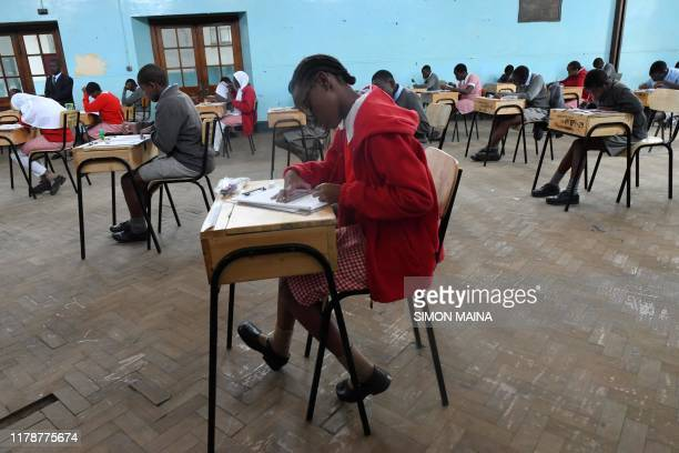 Pupils from Nairobi primary school sit for their exams at the start the Kenya Certificate of Primary Education examinations in Nairobi on October 29...