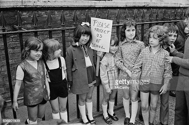 Pupils from schools in Hoxton join a protest at Downing Street in London requesting guards for their schools to defend them against sexual assault UK...