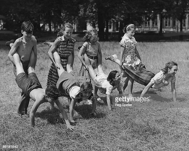Pupils from the Italia Conti School of Dancing hold their annual sports day in Green Park London 25th July 1952 From left to right they are Jimmy and...