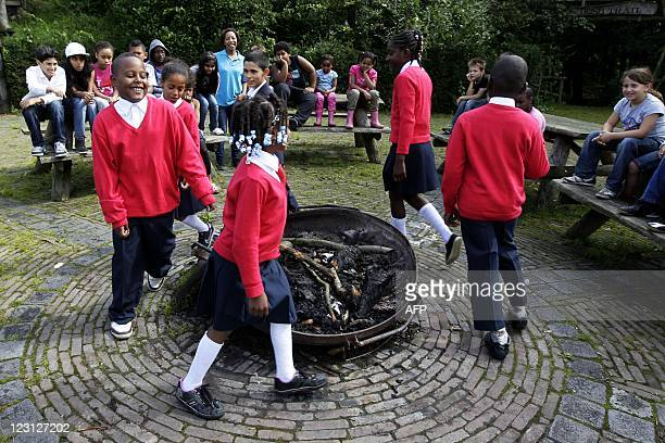 Pupils from the private school Bizzie Kids Basic in Almere play games as they wear their uniforms for the first time at a schoolcamp in Erm, on...