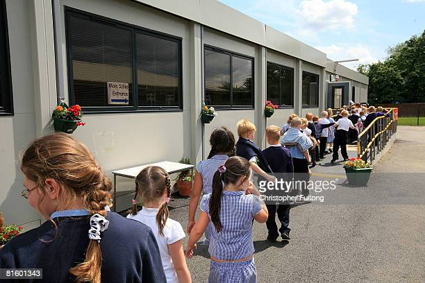 Pupils from Tol Bar Primary School in the Yorkshire village of Toll Bar line up to go into their temporary class rooms on June 17 Doncaster...