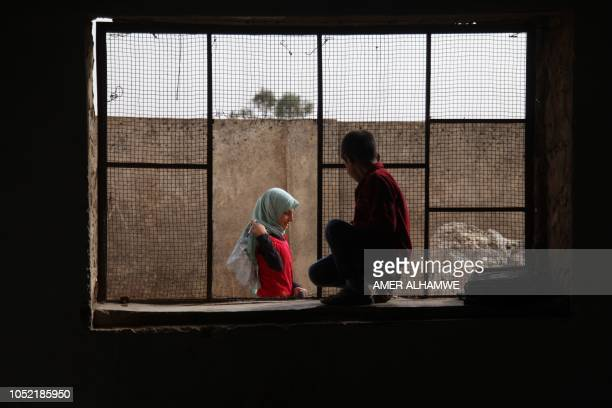 TOPSHOT Pupils gather in front of a classroom at a school in the city of Harim in the rebelheld northern countryside of Syria's Idlib province on...