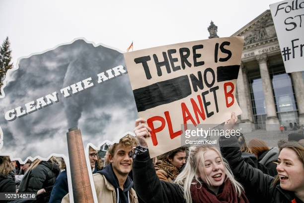 Pupils gather in front of the Reichstag for a five minutes to 12 protest for more active government climate policies on December 14 2018 in Berlin...