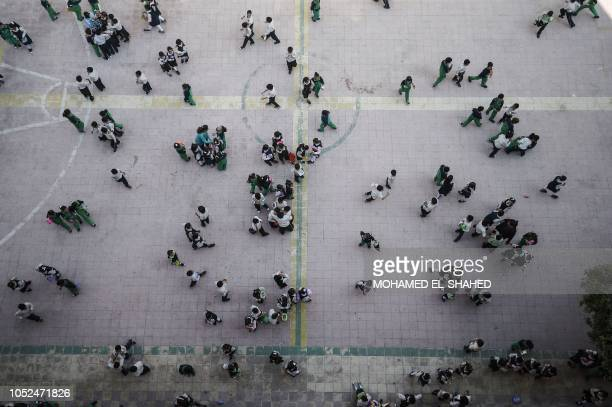 TOPSHOT Pupils gather in the courtyard of the Mahaba school In Ezbet alNakhl a shanty town north of the Egyptian capital Cairo on October 13 2018 In...