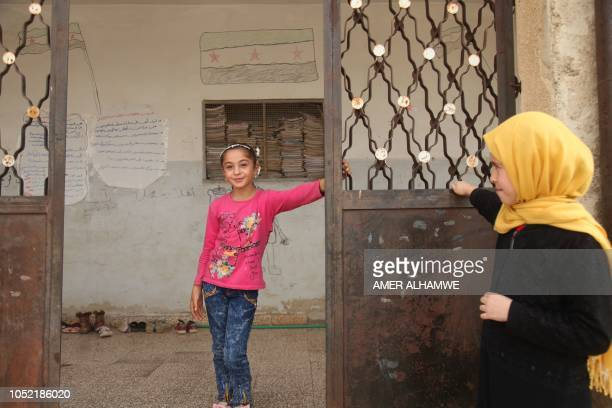 Pupils gather in the courtyard of their school in the city of Harim in the rebelheld northern countryside of Syria's Idlib province on October 15...