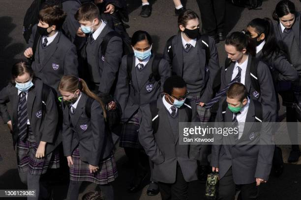 Pupils gather in the playground for a break on their first day back from lockdown at Chertsey High School on March 09, 2021 in Chertsey, United...