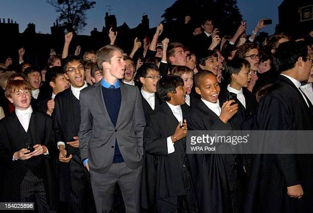 Pupils give three cheers for the arrival of Queen Elizabeth II at Eton College where the college is having a dinner and music concert in celebration...