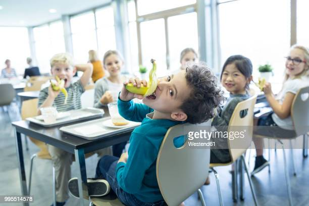 pupils having lunch in school canteen - catering building stock pictures, royalty-free photos & images