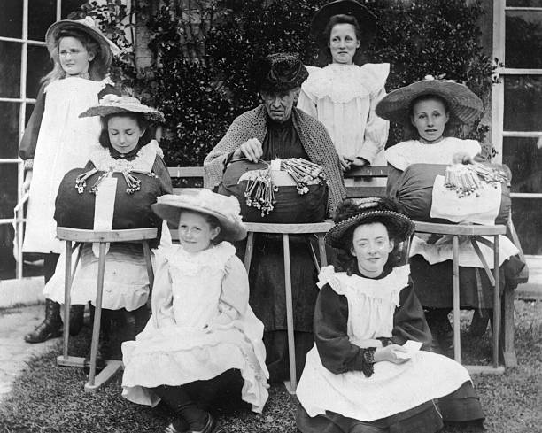 Pupils in their white pinafores and hats at Lois Weeden's...