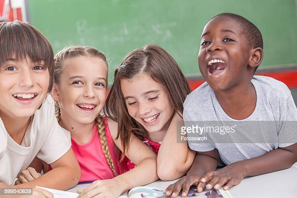 pupils laughing together - junior girl models stock pictures, royalty-free photos & images