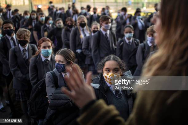 Pupils line up ready for class on their first day back from lockdown at Chertsey High School on March 09, 2021 in Chertsey, United Kingdom. Chertsey...