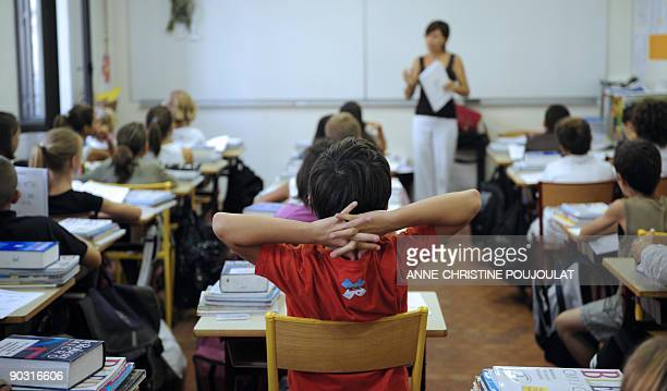 Pupils listen to their teacher in a classroom on September 3 2009 in Marseille southern France on the first day of the school year AFP PHOTO...