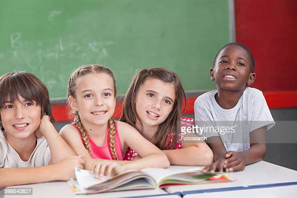 pupils looking at the teacher - junior girl models stock pictures, royalty-free photos & images