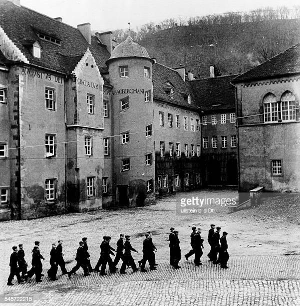 Pupils marching over the courtyard of the 'National Political Institute of Education' in Schulpforta near Naumburg