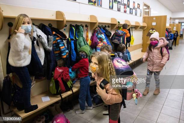 Pupils of 2nd and 3rd grades of Orehek primary school arrive to school wearing facemasks on their first day. After months of lockdown, primary...