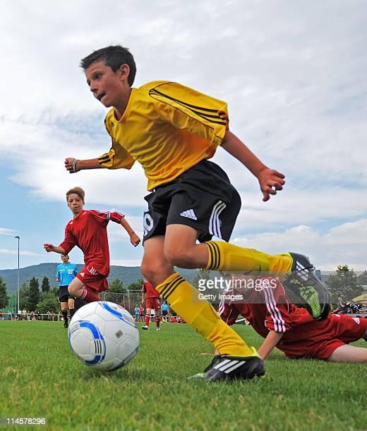 Pupils of Heinrich-Heine Gymnasium Kaiserslautern and Staedtisches Theodolinden-Gymnasium Munich battles for the ball in final game during the DFB...