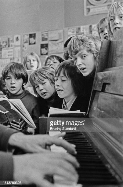 Pupils of Islington Green School in London at a music lesson with a piano accompaniment, UK, 7th November 1973.