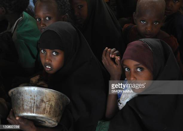 Pupils of Lolkuta north primary school wait in the classroom for food distribution on July 21 2011 in Wajir west Relief groups appeal for more funds...