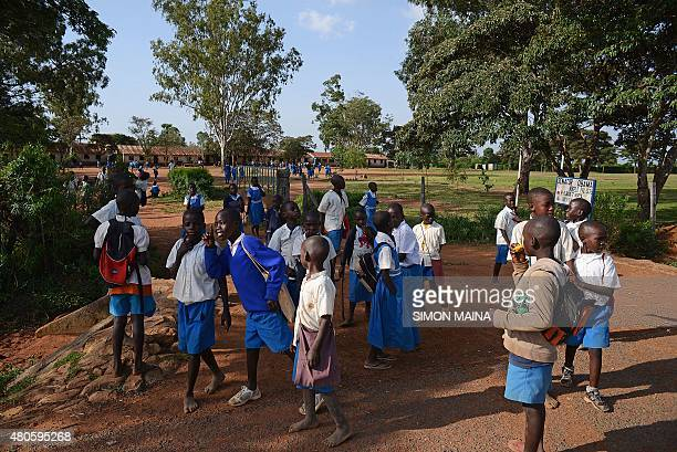 MCCONNELL*** Pupils of Senator Obama Kogelo primary school head home after classes in Kogelo on July 13 2015 The school was renamed after the US...
