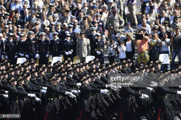 Pupils of the Ecole Polytechnique promotion X2016 march during the annual Bastille Day military parade on the ChampsElysees avenue in Paris on July...