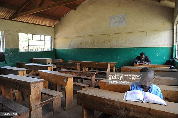 Pupils of the St Paul Primary School in Nairobi sit in an empty classrom on January 26 after the school closed entering its second week in a dispute...