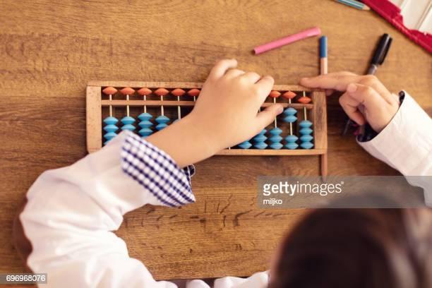 pupils on class in school - abaco imagens e fotografias de stock