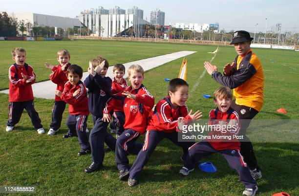 Pupils on the sports field at Dulwich College, Pudong, Shanghai. 30 December 2004