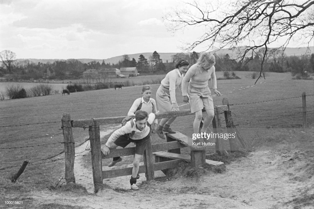 Pupils out for a cross-country run near Bedales Boarding School in Steep, Hampshire, January 1941. Original publication: Picture Post - 403 - Bedales Boarding School - pub. 4th January 1941