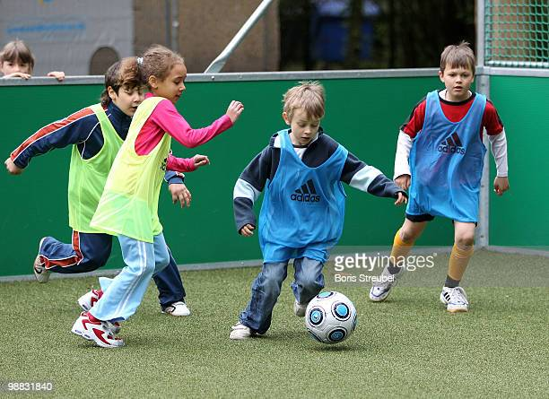 Pupils play soccer on one of the DFB mini soccer fields on the day of action under the slogan 'Mitspielen kickt Starke Kinder Wahre Champions' at the...