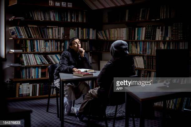 Pupils practice to sing the Koran on October 16 in a library at the European Institute of Social Sciences in SaintLegerdeFougeret central France The...