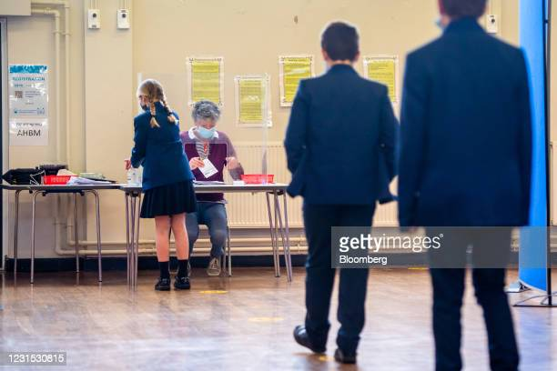Pupils queue up before taking a Covid-19 test at All Saints Catholic College in Dukinfield, Great Manchester, U.K., on Friday, March 5, 2021. On...